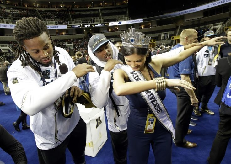 Miss Universe dabbed with Panthers players at Super Bowl Opening Night