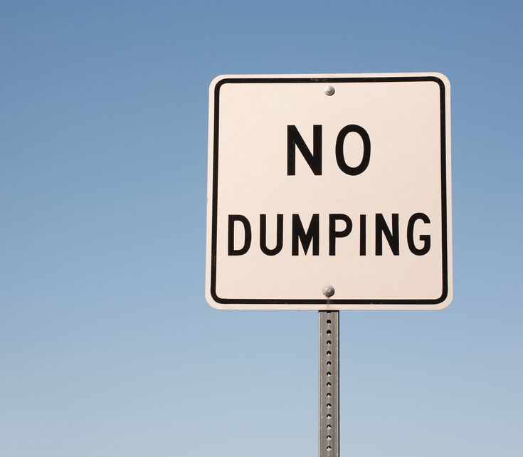 No dumping sign and blue sky with copy space.
