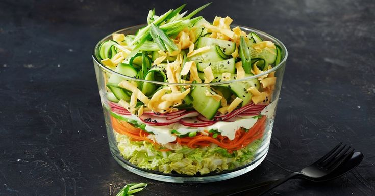 Layers of wombok cabbage, carrots and other fresh vegetables make this Asian shredded salad a vibrant centrepiece.