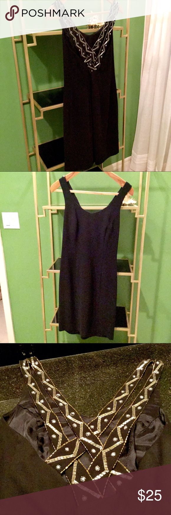 Black Back Beaded Dress.  PRICE SLASHED!! The little black dress with a big surprise!  Beautiful beaded crisscross straps in back.  PERFECT CONDITION!  Dry cleaning is always recommended before wearing. CDC Dresses