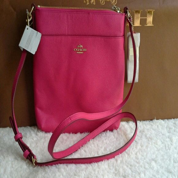 """Coach swingpack Hot pink embossed textured leather north south swingpack. Measures 8 1/2 x 8 1/2"""".  Hasone outside pocket and one inside multifunction pocket. Coach Bags"""