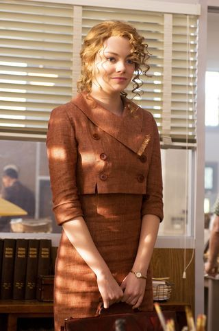 """Emma Stone in The Help: """"Skeeter was a bit of a tomboy. She didn't care how she looked. Her objective was to appear business-like, not feminine or masculine,"""" said [director Sharen Davis], who consulted photos of students from a 1960s Ole Miss yearbook for ideas for the character's coordinated sportswear separates in earth tones."""
