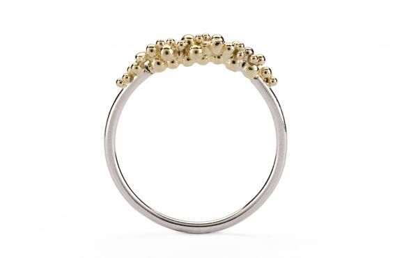This exquisitely delicate ring is partially encrusted with fine 18ct yellow gold granulation with a Silver band.  This ring is also available in silver or  oxid