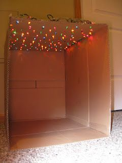 """star"" box with Christmas lights - hmmm at least one moving box space shuttle downstairs could transform to a reading nook"