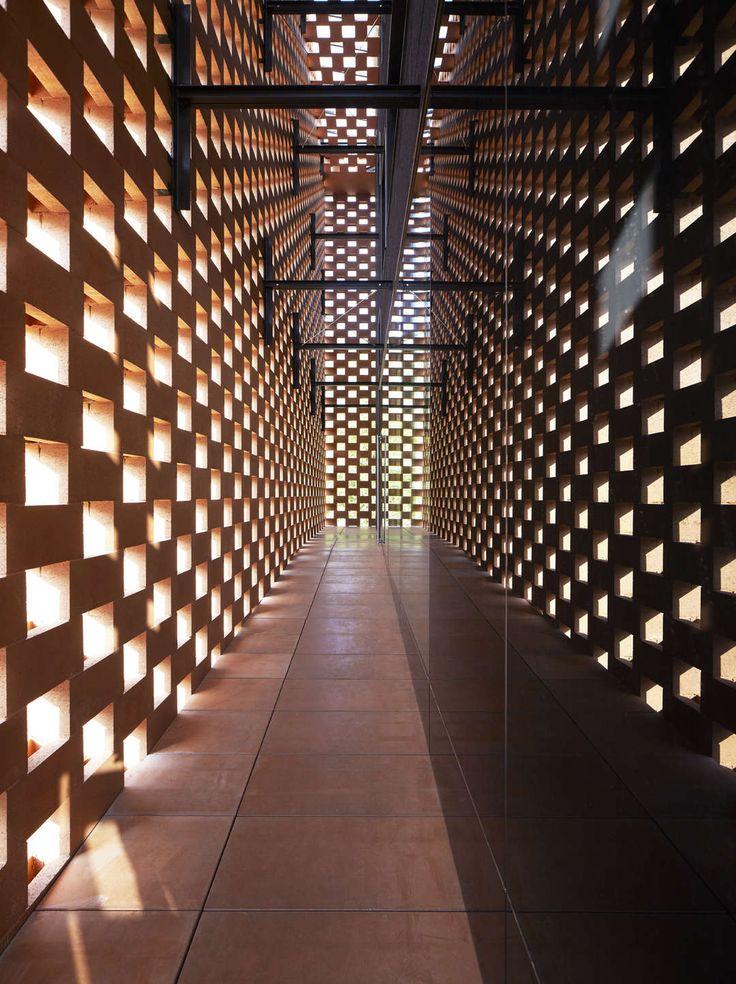 Werner Tscholl's Puni Distillery Is a Glowing Lantern of Cement Bricks - Architizer