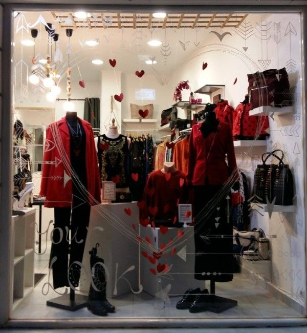 Valentine's shop window in Brands Bazaar boutique, Salamis, Greece! Perfect black and red balance with hearts coming out of a glass bottle! Awsome!