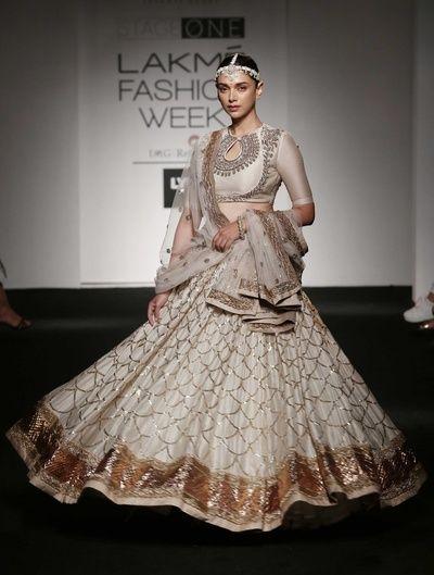 off white blouse, silver zardosi work, off white lehenga, gold tilla work, off white and copper net dupatta
