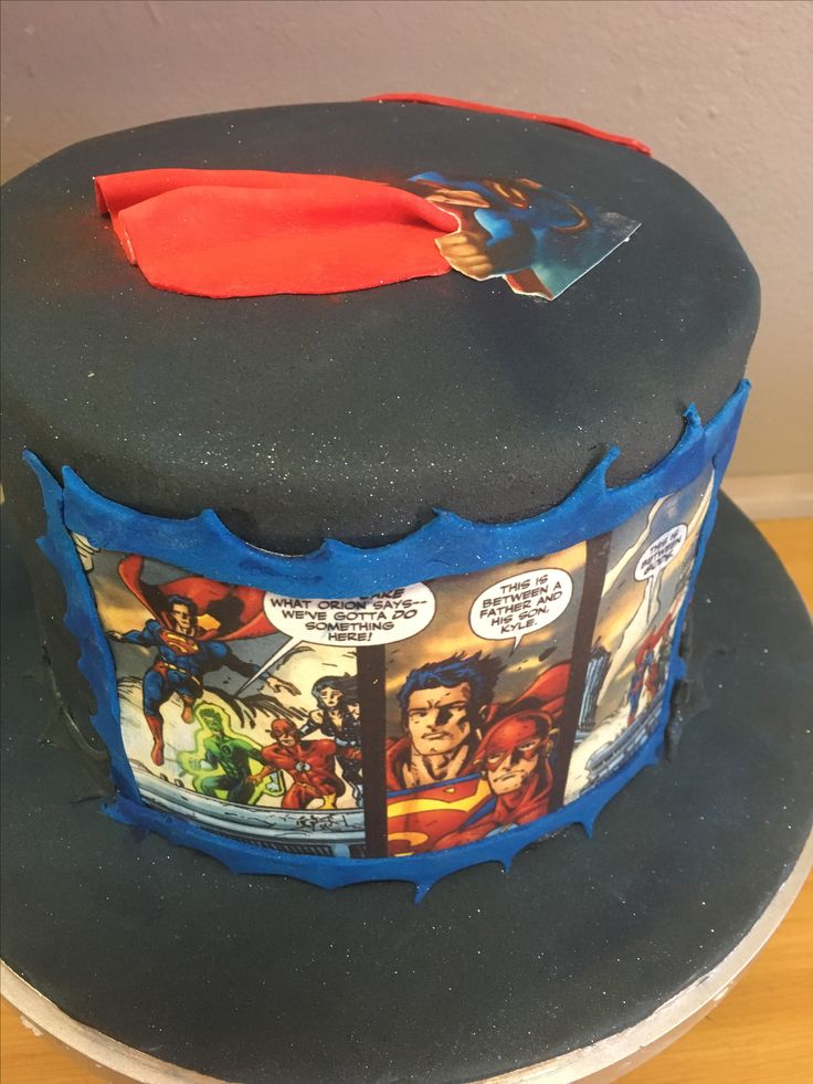 Vanilla sponge cake filled and covered with buttercream and fondant, decorated with edible Superman cartoon prints