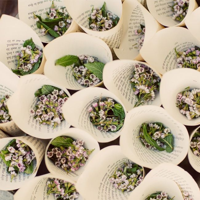 Cones made from book pages were filled with tiny flowers for guests to toss after the ceremony in celebration.