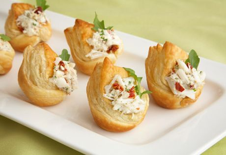 Four distinctive ingredients come together easily to make thesecheesy bite-sized appetizers. Sun-dried tomatoes add unexpected flavor and a sophisticated touch.