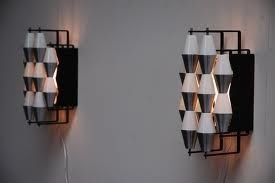 'LUDIEK' large wall lamps. Produced by RAAK, Amsterdam, Holland, 1960.