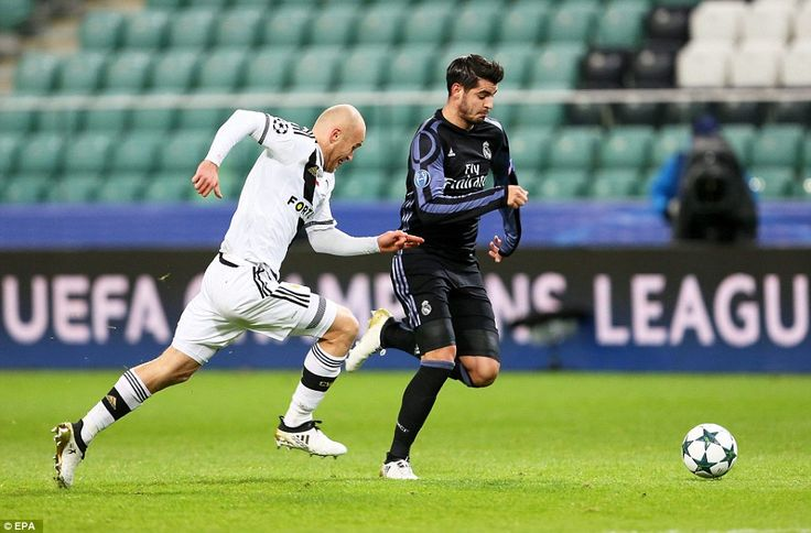 Legia Warsaw defenderMichal Pazdan chases after Spanish striker Alvaro Morata as Real Madrid go on the attack