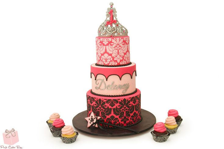 Four years ago we had the pleasure of creating Danica's 1st birthday cake. This year it's Delaney's turn!  Details include a glittery and girly silver crown with pink crystals, damask and quilted patterns.  Pink and black colors - perfect for the birthday baby!
