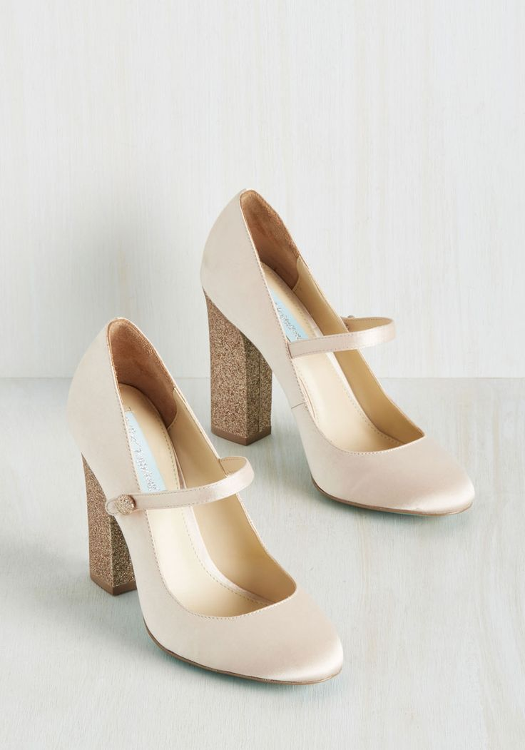 You may not have heard a pair of pumps described as generous before, but that's because none have offered the giddiness and prettiness that this Betsey Johnson pair does! Blissfully swathed in the palest pink satin and standing atop glittery block heels, these faux-buttoned Mary Janes are fully committed to making you happy.