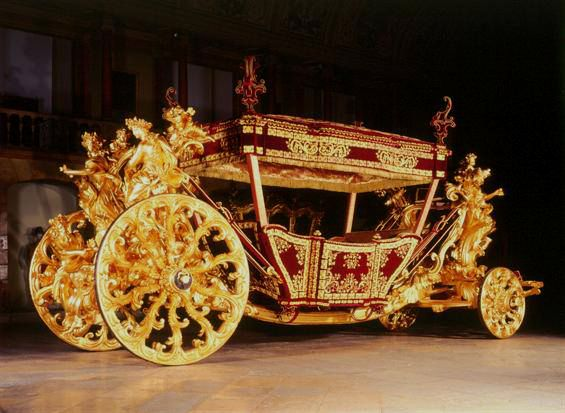 Golden Portuguese Embassy Coach - Named Oceans a 18th century (1716) Triumphal vehicle. One of the coaches of the embassy sent to Clement XI in 1716 by Portuguese King João V. The decoration represents the Atlantic Ocean meeting the Indian Ocean.