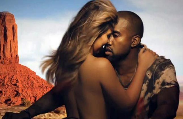 Kim gets naked for beau Kanye's video, romances on bike (VIEW IN PICS)