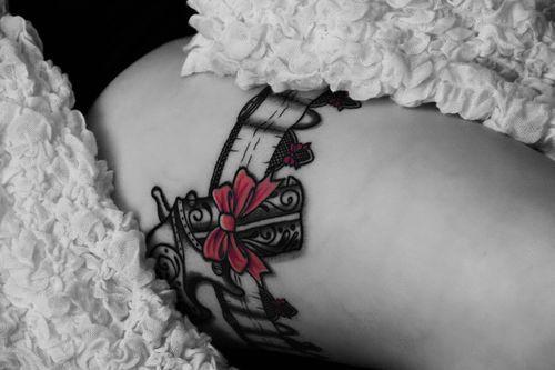 garter tattoo.