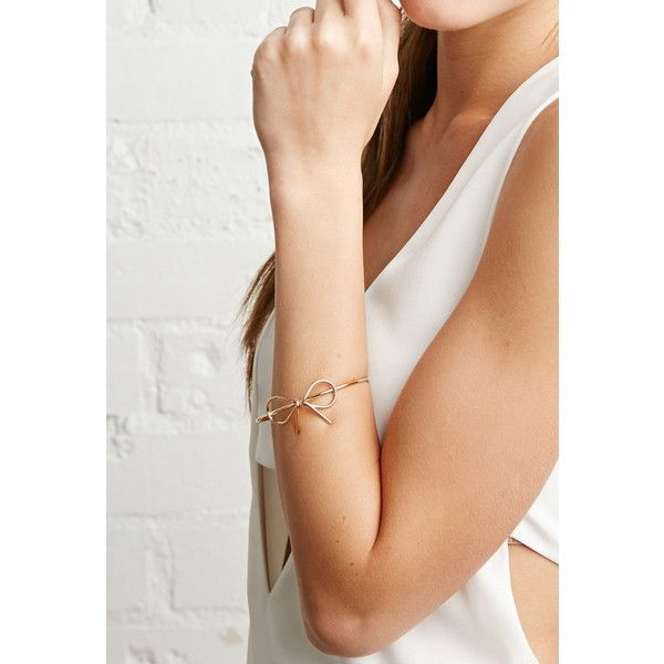 Forever 21 Bow Wire Wrist Cuff ($5.90) ❤ liked on Polyvore featuring jewelry, bracelets, forever 21 jewelry, forever 21 bangle, polish jewelry, wire bangles and forever 21