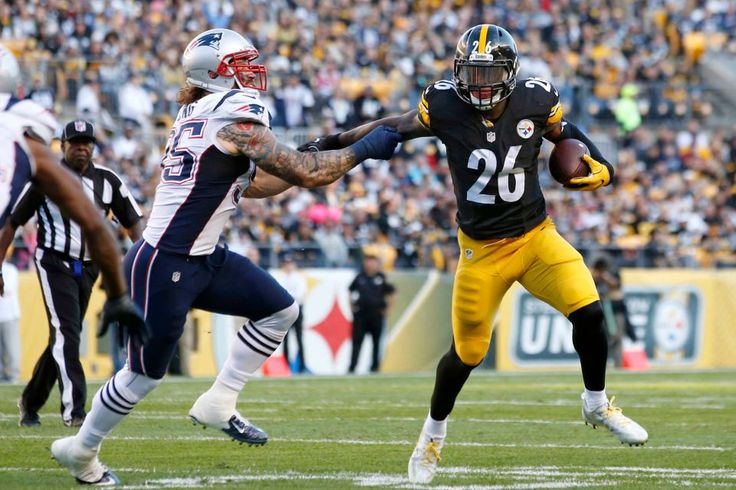 Patriots vs. Steelers:     October 23, 2016  -  27-16, Patriots  -    Pittsburgh Steelers running back Le'Veon Bell (26) gets around New England Patriots defensive end Chris Long (95) during the first half of an NFL football game in Pittsburgh, Sunday, Oct. 23, 2016.