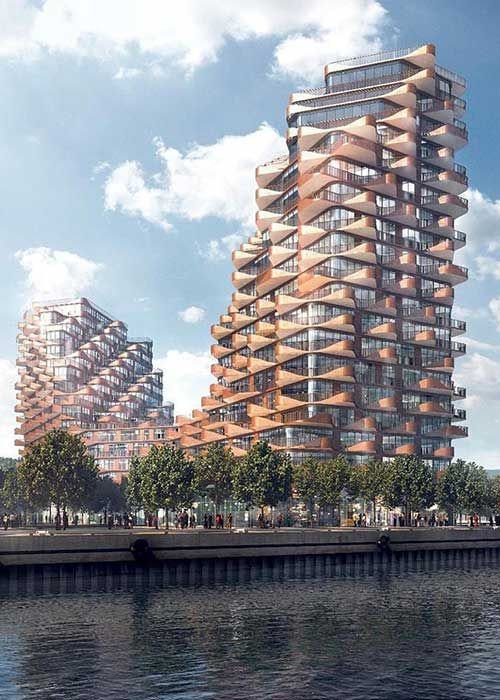 The Waves at Bayside- Located on the lakefront of Lake Ontario, this amber coloured structure rises 14 storeys, dips to 7 storeys at its centre, ascends again to 14 storeys. Live in Toronto in a luxurious house of your choice, a decision you will always be happy about.     #TheWavesatBayside