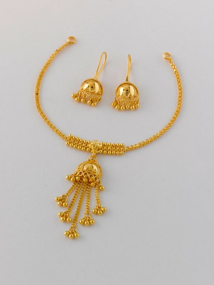 Small is beautiful !! A cute little number that's sure to catch the eye. With matching half jhumka earrings, in 22K hallmarked gold.   Necklace: 9 gms weight and price Rs. 30,000/-  Earring : 3.5 gms weight and price Rs. 11,500/-