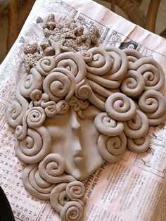 You could copy this idea in polymer clay! It is very unique looking to me.I like it very much. Nautical Clay Face Plaque - Stage one - drying by A2SeaCreations, via Flickr