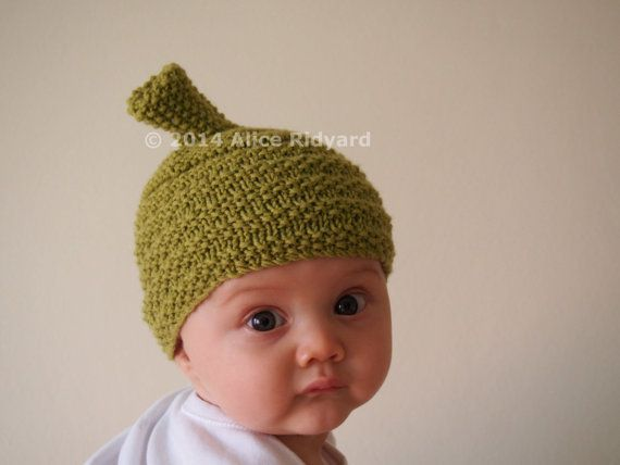 gumnut baby hat pattern - knitted green wool with ribbed seed stitch bonnet and stalk