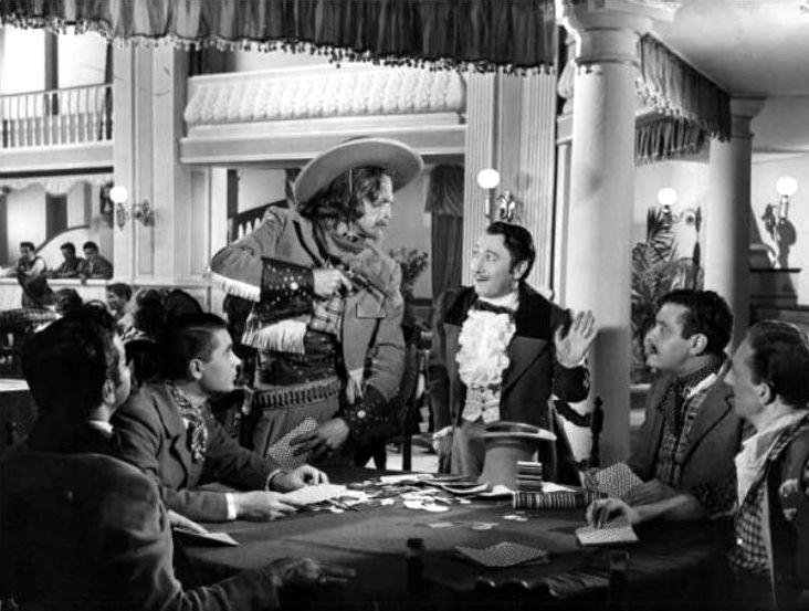 """Macario (Erminio Macario, the third from the right) in Mario Mattoli's """"Adamo ed Eva"""" (English title: """"Adam and Eve"""", 1949), also starring Isa Barzizza."""