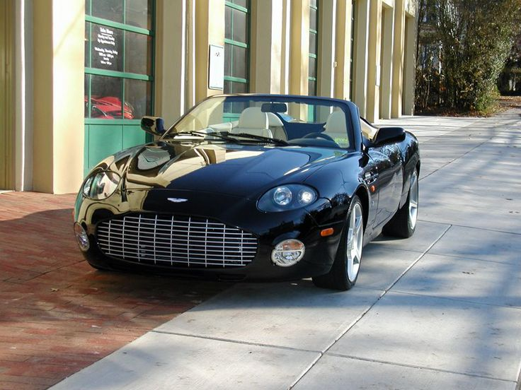 2003 Aston Martin DB AR1 Zagato #52 of 99 DB AR1 Zagato roadsters produced. Black with magnolia leather. 435hp 6.0-liter V12 and 6-speed gearbox.  SOLD