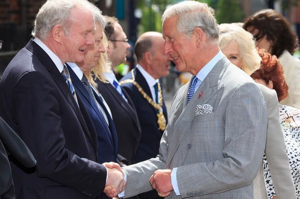 Prince Charles shakes the hand of Deputy First Minister Martin McGuinness