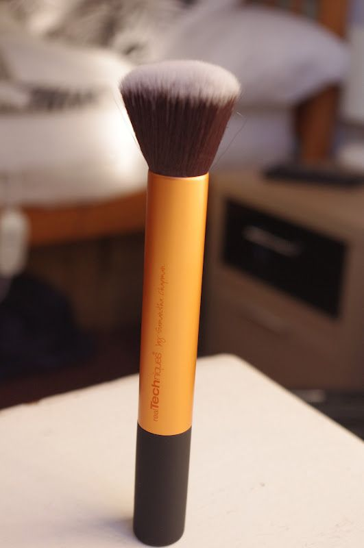 Real Techniques buffing brush...best brush on the market in my opinion, and its quite affordable.