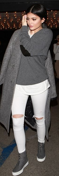 Who made  Kylie Jenner's zipper sneakers, white ripped skinny jeans, and gray v neck sweater?