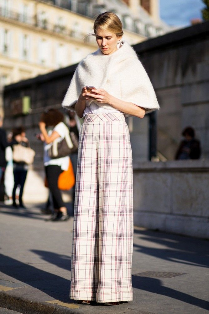 Structured white cape paired with white checkered palazzo pants