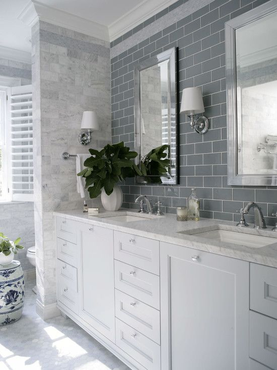 Traditional Full Bathroom with Complex marble counters, Subway Tile, penny tile floors, Wall sconce, Undermount Sink, Flush