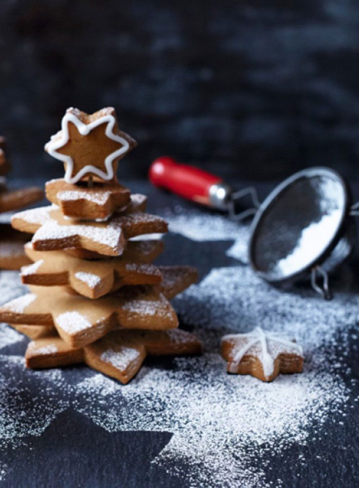 Turn star-shaped cookies into these impressive Christmas trees.  Make a simple Royal icing with icing sugar and egg whites to help glue these trees together and use different sized star cutters to get the tree effect.