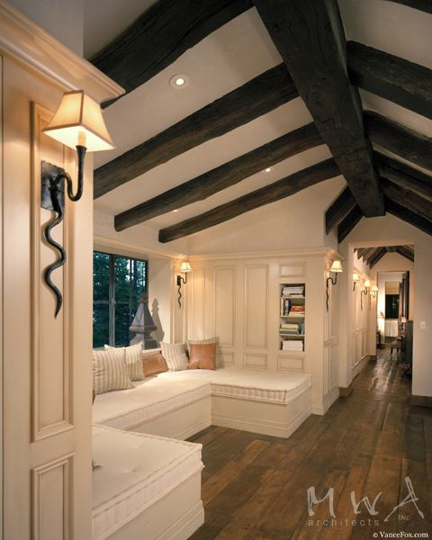 hall window seat, white wood paneling, reclaimed dark wood beams, reclaimed wood floor