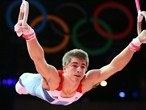 Max Whitlock of Team GB trains on the rings. loveeeee