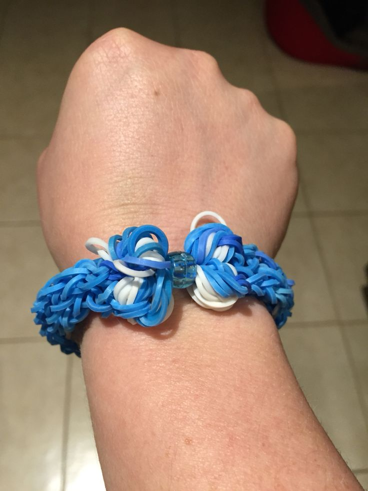 A nod to my footy team ...awwww❤️ A blue and white, butterfly bow bracelet ...inspired by the world of YouTube Rainbow Loom Tutorials