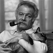 Georges Brassens with pipe and cat
