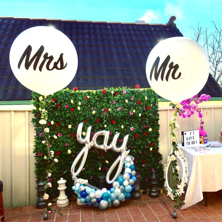 Gorgeous #mr and #mrs  #jumboballoons with #rose #garland for a #kitchentea party.