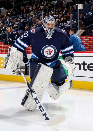WINNIPEG, MB - NOVEMBER 2: Goaltender Connor Hellebuyck #37 of the Winnipeg Jets hits the ice prior to puck drop against the Dallas Stars at the Bell MTS Place on November 2, 2017 in Winnipeg, Manitoba, Canada. (Photo by Jonathan Kozub/NHLI via Getty Images)