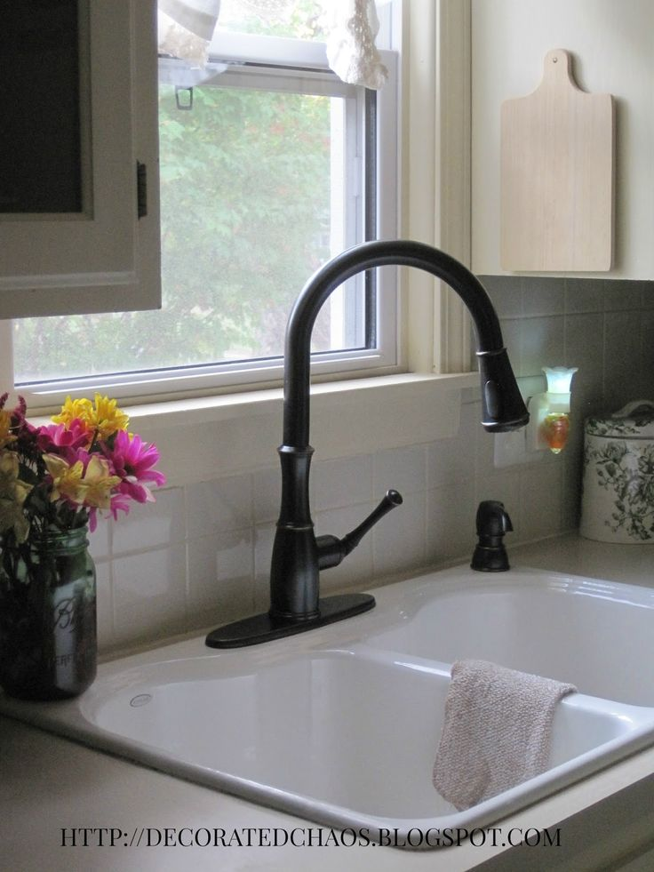 Decorated Chaos-new Pfister faucet in Tuscan Bronze and white cast iron sink.