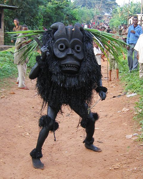 "Africa | Ekpo Masquerader. Ututu, Abia State, Nigeria. 2005 | ©Eli Bentor ""Stupid dog you make me look bad! ooga booga booga!""- Eustus"