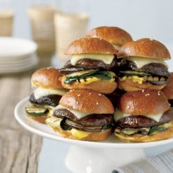 Grilled mini portobello burgers offer vegetarians a savory option for the main course.