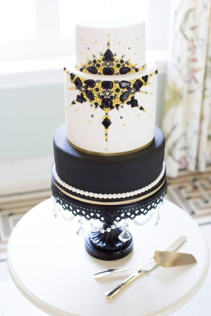 Black, Gold & White Art Deco Hollywood Glam Wedding Cake on Black Cake Stand See more here: http://www.opulenttreasures.com/shop/chandelier-round-cakes-set-of-3