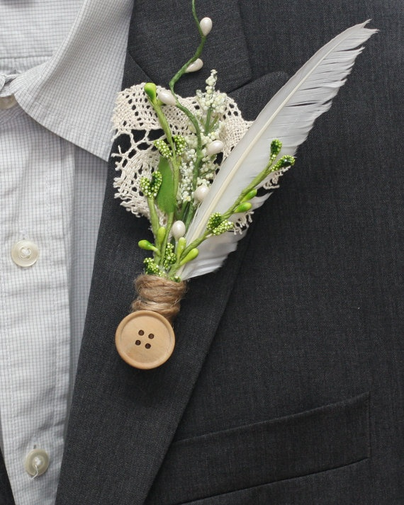 I could hand-make his boutonniere. I like the lace and button and twine and greens (although I would replace the feather with a piece of wild grass).
