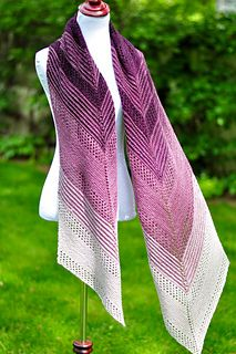 Changing Light is a fully reversible scarf or wrap featuring stripes, lace and elegant pointed tips.