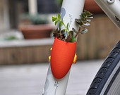 Orange Bike Planter: A Wearable Planter for Your Bike.