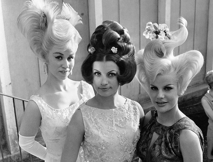 """The prize-winning coiffures in a contest in Munich, Germany on May 1, 1964. They were designed for evening wear and hairdressers said anyone with a little time can copy them. (AP Photo)"""