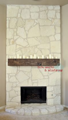 Redoing the fireplace to look like this one. All that I'll need is the wood pieces, stain, and paint for the stone. I believe it'll be an easy convert. :D